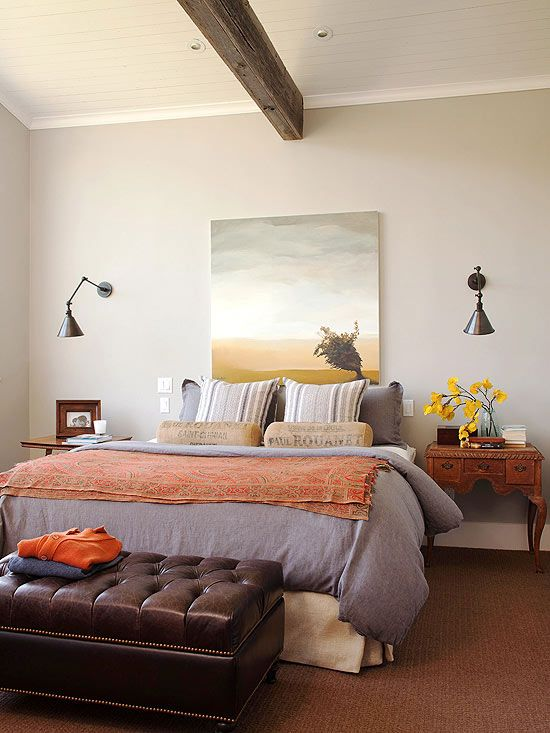 Love the color palette in this room. The dark brown and gray neutrals with the lighter hues of blue and orange. Has a calming desert feel but sophisticated style.