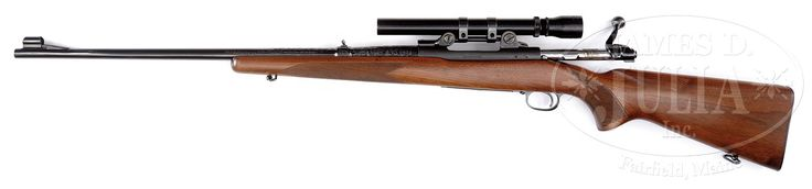 CUSTOM ENGRAVED PRE 64 MODEL 70 WINCHESTER RIFLE WITH BAUSH & LOMB SCOPE.