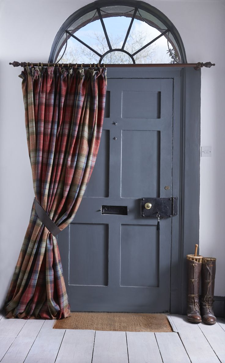 The perfect addition to a country home doorway, a thermal wool door curtain complete with leather tieback. (farrow & ball down pipe grey painted door)
