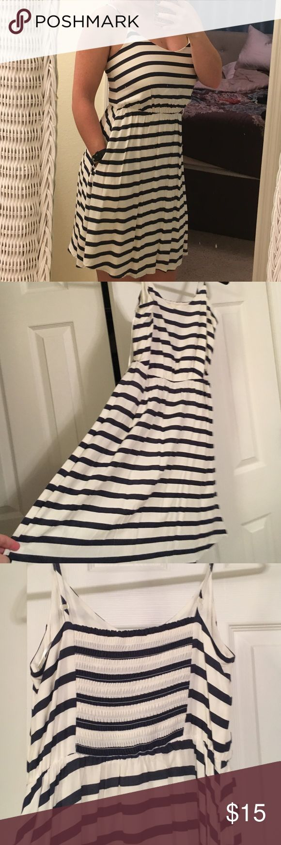 Adorable nautical sundress from LC Lauren Conrad Perfect summer dress! Nautical look with navy and white stripes. Never worn because I bought it not realizing it was too tight in the top. Straps are adjustable and the dress has pockets, both of which i LOVE! The dress is 100% rayon for a nice lightweight flown feel with a polyester lining. Open to offers!! LC Lauren Conrad Dresses