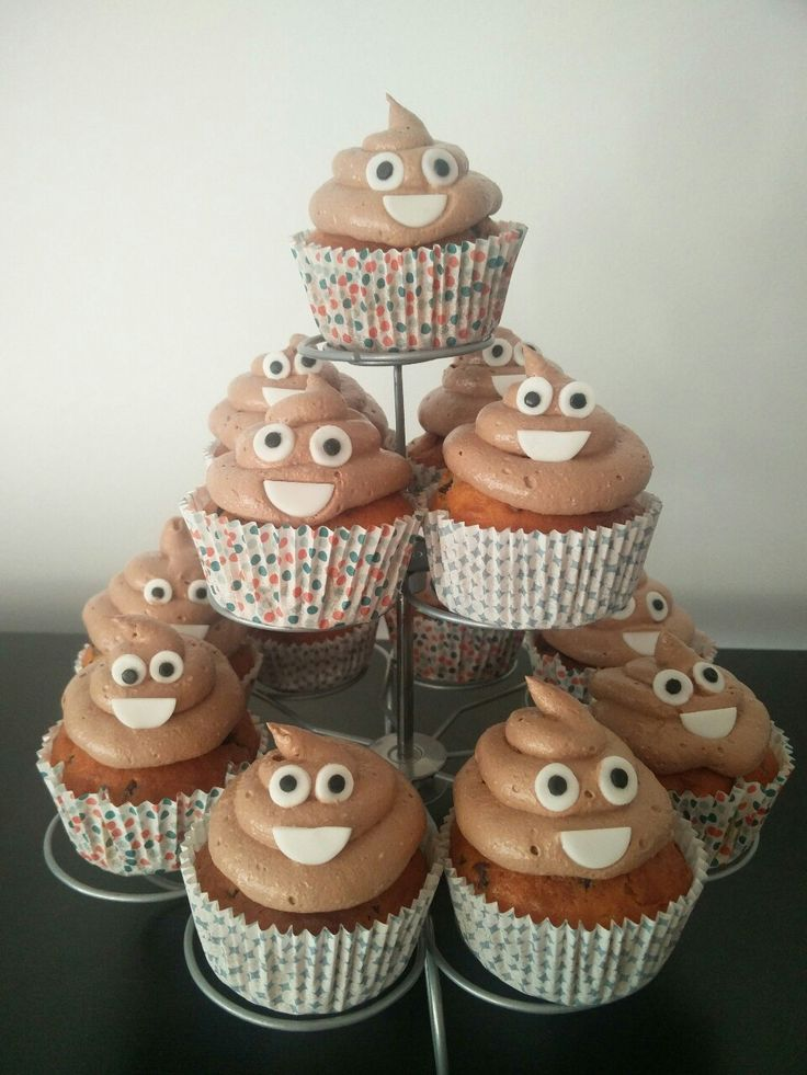 Poop Emoji CupcakesI made these for my friend and they loved it! They are vanilla cupcakes with chocolate chips and a filling of red fruit jam. The 'poop' is made from chocolate italian buttercream and decorated with fondant eyes and smiles.
