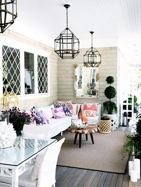 Porch Love. Great everything: driftwood colored porch, black iron and glass lighting, diamond pane windows, neutrals with pops of pink n purple, etc. | fabuloushomeblog.comfabuloushomeblog.com