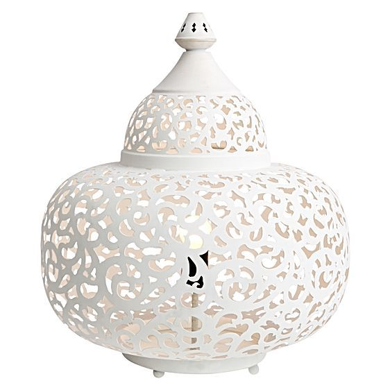 Enhance the feminine elegance of your home with the Moroccan scroll design of the Iron Makti White Table Lamp from Casa Uno.
