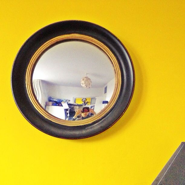 Ebony black and gold convex mirror