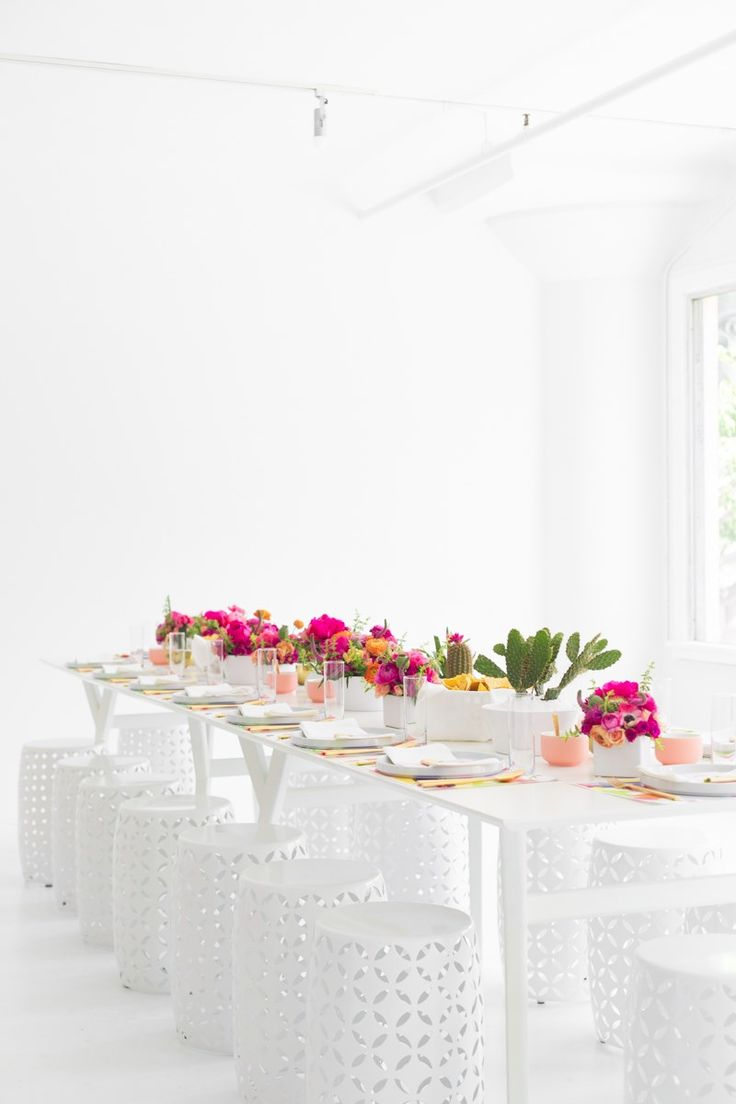 Long party table with white stools Design Trend: Dining Stools
