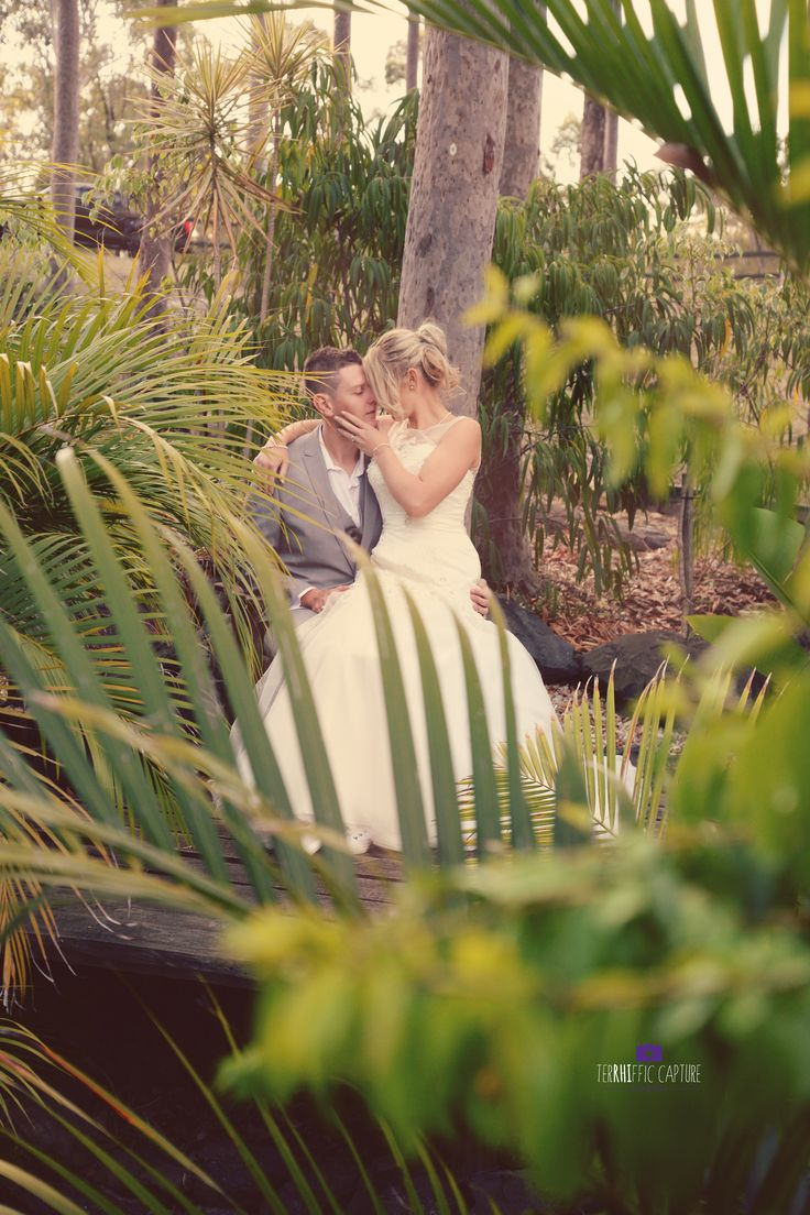 Vintage Garden Wedding Photography. Beautiful white lace dress. Secluded kissing.