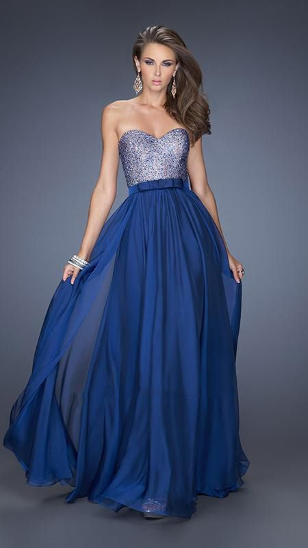 La Femme - Prom Dress 20041: Classic chiffon gown with a chic satin bow belt. The sweetheart bodice is nude and covered with small…
