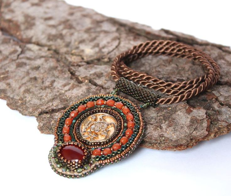 bead embroidered pendant with old button and karneol