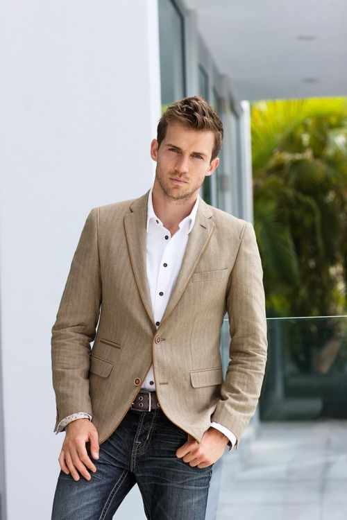 Shop this look for $121:  http://lookastic.com/men/looks/tan-blazer-and-white-longsleeve-shirt-and-brown-belt-and-charcoal-jeans/1434  — Tan Blazer  — White Longsleeve Shirt  — Brown Leather Belt  — Charcoal Jeans