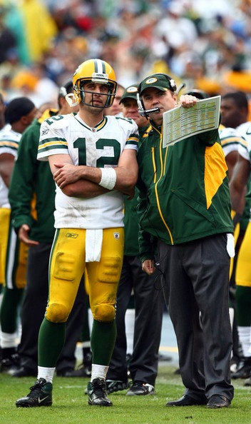 Mike McCarthy and Aaron Rodgers, probably discussing why we do not have 50 points on the board..