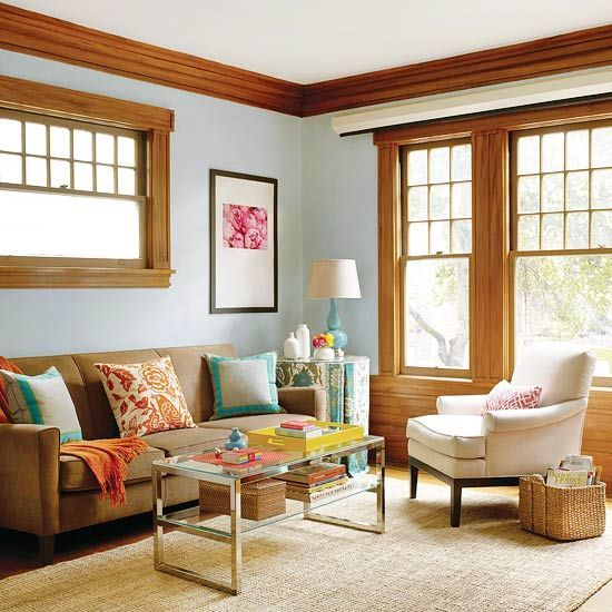 Pale blue walls pair well with the natural woodwork in this space. More Blue Living Rooms:  http://www.bhg.com/rooms/living-room/makeovers/blue-living-rooms/#page=2