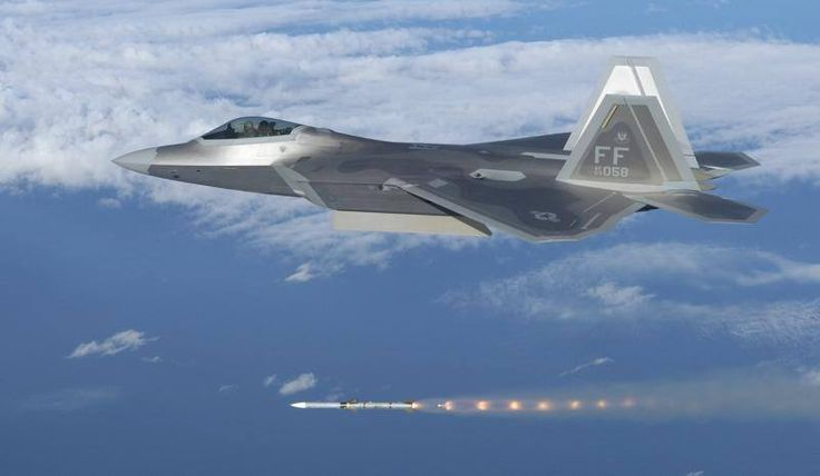 An F-22A Raptor of the 1st Fighter Wing based at Langley AFB (Virginia) launch an AIM-120 AMRAAM.