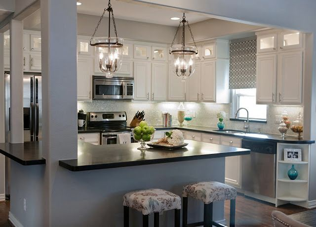 This was one of a couple of inspiration pictures I had used for my own kitchen makeover. Obviously, my budget couldn't afford honed absolute black granite and marble backsplash but I worked with my small budget and played off the look of this kitchen along with a couple others I liked   =)
