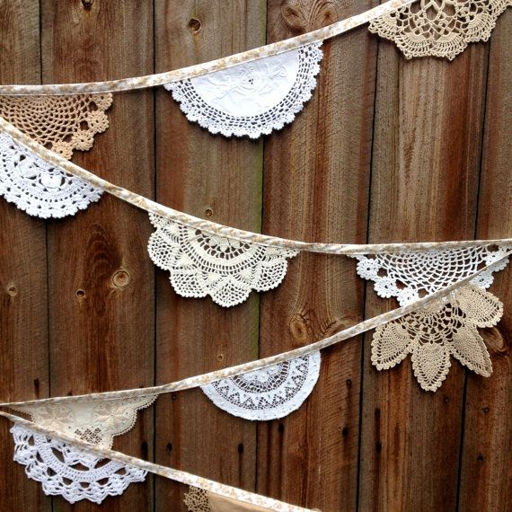 Meet 'Magnolia and Snowdrop', a fine example of vintage crochet doily bunting, handmade in subtle shades of white, cream, brown and beige. It is
