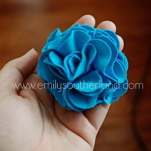 I can't help myself...there are so many cute ones and different ways to make fabric flowers How To Make A T-Shirt Fabric Flower