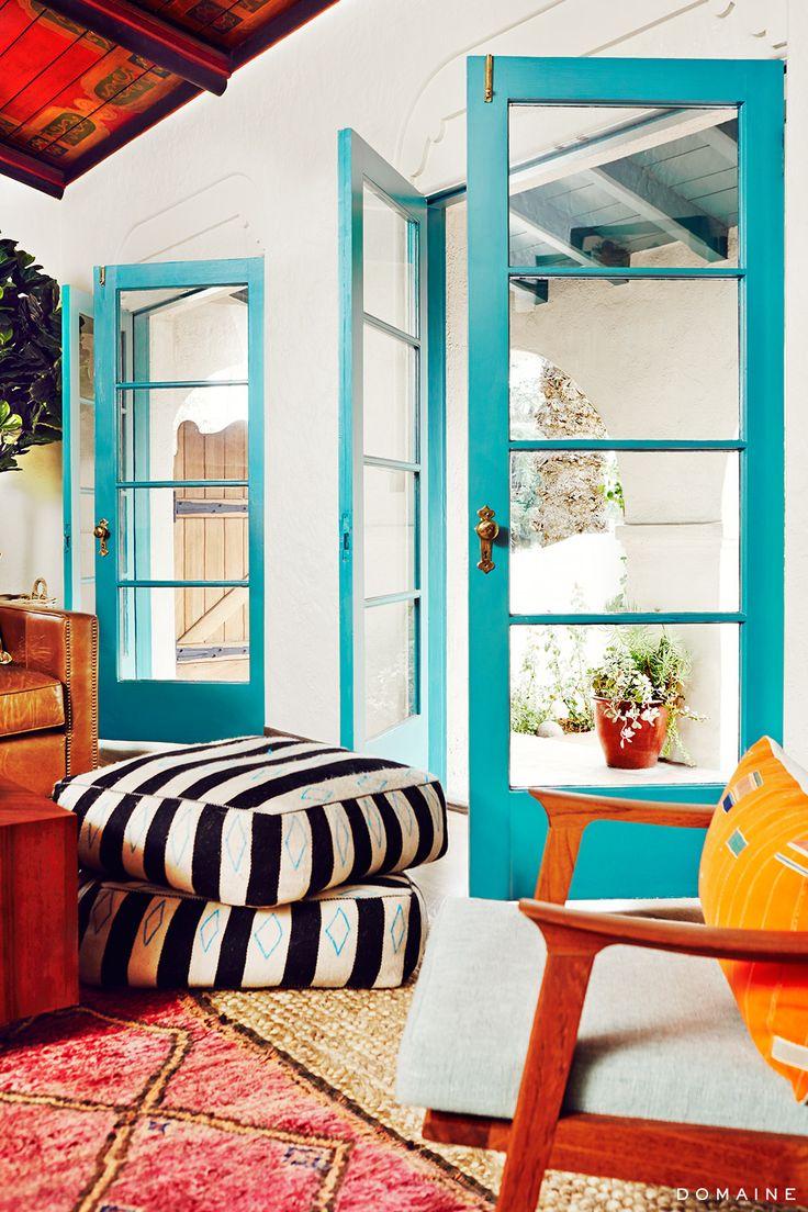 Open turquoise doors to living room