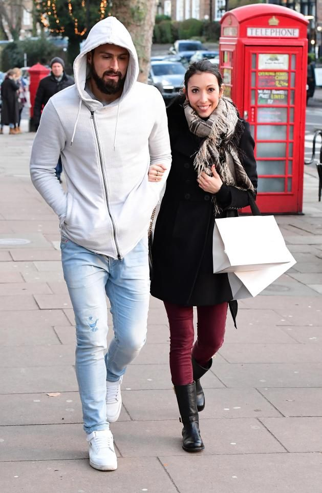 Man of the moment Olivier Giroud was snapped out and about with his wife Jennifer after scoring a stunning opener for Arsenal against Crystal Palace