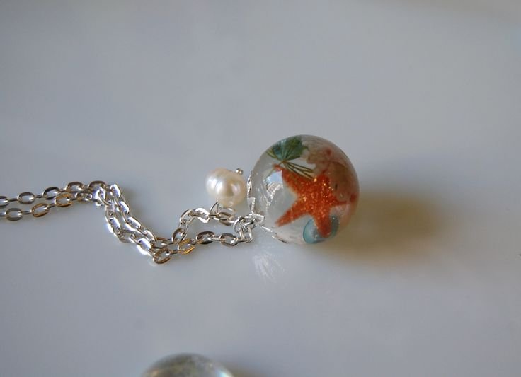 resin globe with starfish, sand,sea shell and small pearls. hand made!!!