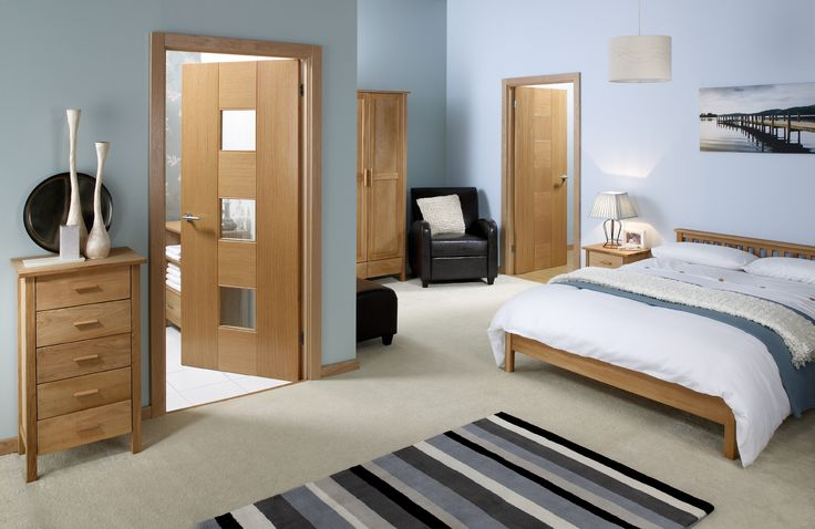 Wood Decorating Ideas for Cool Sky Blue Themed Bedroom with Simple Brown Wood Bedside Table that have White Bedding also Simple Storage Furniture that have Six Drawers also Neutral Brown Wood Door Types