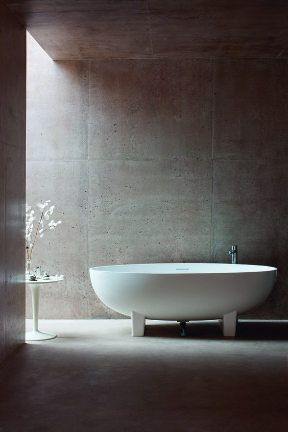 Amazing bathroom design. Love those walls. Dramatic oval shaped bath - Lacrimal natural stone bath from Clearwater Baths.
