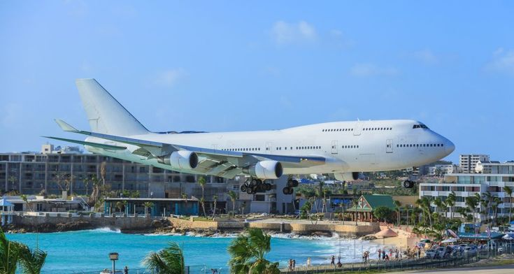 Boeing 747-400 (EC-MQK)  Wamos air flying for Air France over Maho beach area and landing at TNCM St Maarten