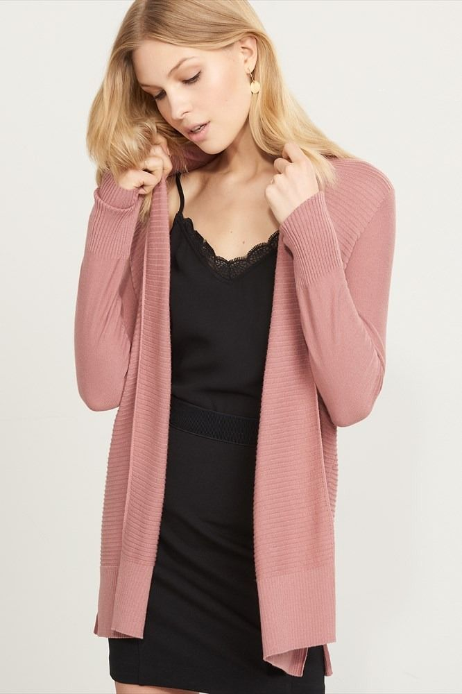 Keep it cozy. This knitted long sleeve cardigan is a wardrobe essential.