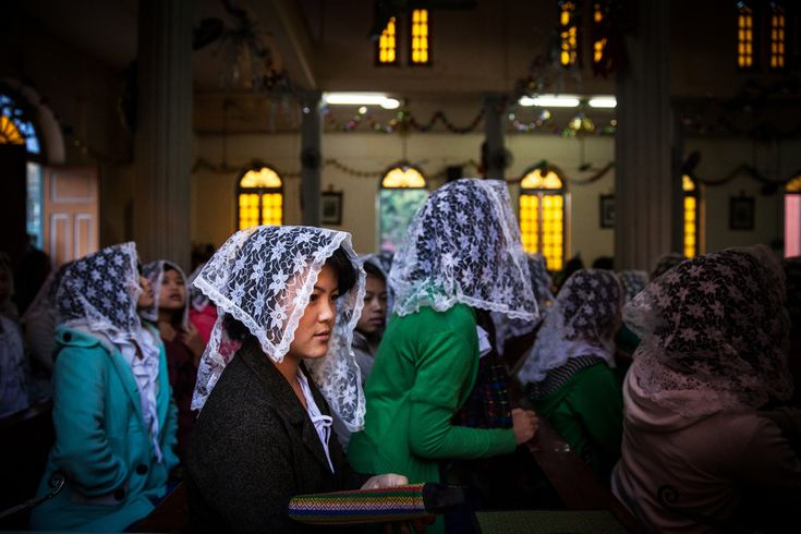 The Kachin are devout Christians in a predominantly Buddhist Burma. Worshippers at morning mass at St. Francis Savor Church in the Myitkyina, Myanmar. © Diana Markosian