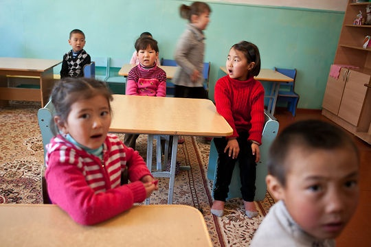 Children sing in a Kyrgyz-language kindergarten in Barskoon, located on Kyrgyzstan's Lake Issyk-Kul, in February 2013. Most schools teach in Kyrgyz or Russian, while Uzbek-language schools are becoming fewer, dropping from 141 Uzbek schools in 2002 to 91 schools in 2012. (Photo: David Trilling)