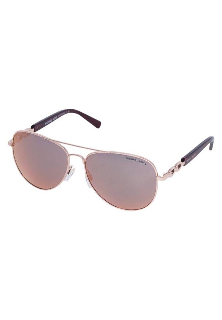 "Michael Kors. Sunglasses - pink. UV protection:yes. lenses:coated glasses. lenses advantage:clear, distortionfree sight. Frame style:aviator. Bridge width:0.5 "" (Size 58). Total width:5.5 "" (Size 58). Glasses case:hard case. Arm l..."