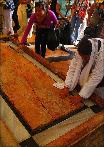 It is believed that this board is where Jesus was laid when he was being prepared for burial. Church of the Holy Sepulcher - Jerusalem  ISRAEL.