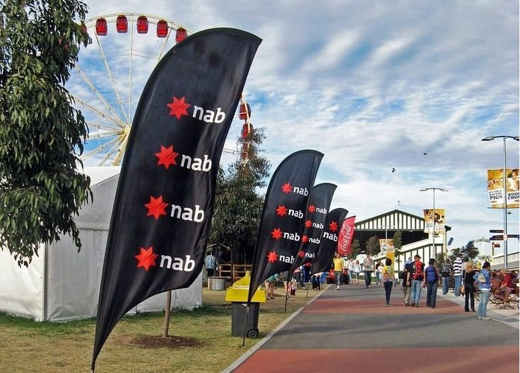 Branded feather flags for an outdoor event.