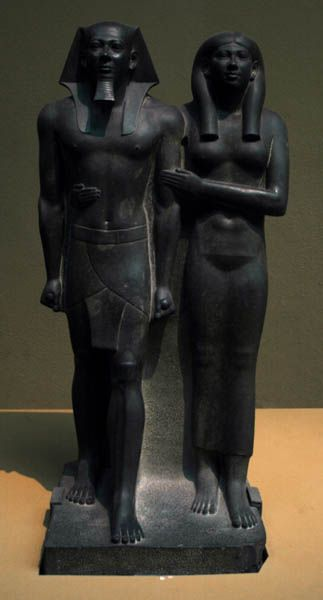 King Men-Kau-Re & his Queen. Reign of Menkaure (c.2551-2523 BC, 4th Dynasty) from Giza, Menkaure Valley Temple made from Graywacke.    love how she holds her king.   Welcomes you at the entrance of the show room at the Boston Art museum. more info here  in Boston section. http://www.ancient-egypt.co.uk/index.htm