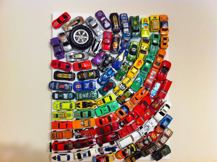 Made this for my sons play room.. Old hot wheels glued to a canvas