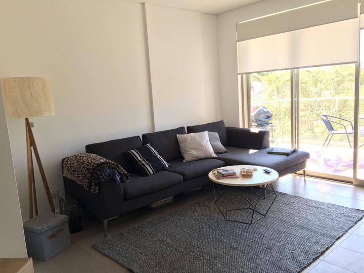A Cosy One Bedder in Marrickville - Before: Erin and Bryson's living room with existing furniture - Online Interior Design Service