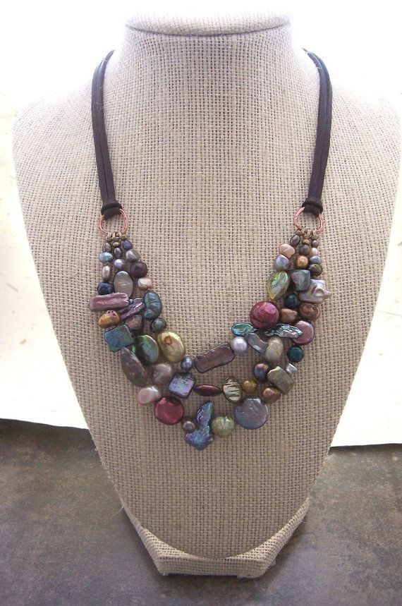 This Multi Stranded freshwater pearl necklace is created by knotting assorted pearls onto silk . The colorful textural assortment of pearls makes this freshwater pearl necklace truly unique. The pearls are hung from deer hide suede which is super soft/ supple and comfortable.   You may choose your length and color suede. Each piece comes with a 2 inch extension for extra adjustability.