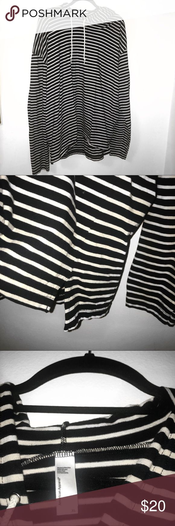 AMERICAN APPAREL Striped Hooded Long Sleeve Super comfy cotton American Apparel brand hooded long sleeve. Has small slits on the sides and a good with pulls. Cozy for winter! Ladies can wear oversized with leggings or jeans and men can wear for a comfortable winter piece. Washed and worn once, in perfect condition! American Apparel Shirts Sweatshirts & Hoodies