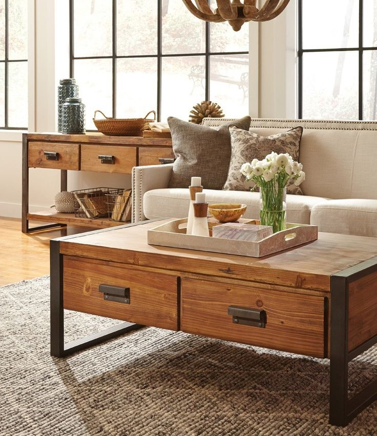 Upgrade the style of your living room with our Rustic Industrial Coffee Table with Drawers. Crafted of solid Reclaimed Pine wood, industrial style metal legs and drawer pulls. Two drawer provide plenty of storage space. Make a sophisticated statement in your home design with this unique furniture.