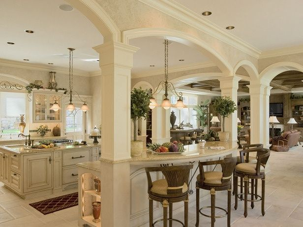 Open kitchen and living. Love the columns and the arches