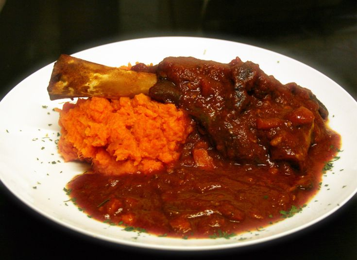 Learn how to make these delicious slow cooker lamb shanks; done with a tomato and mushroom sauce, and a creamy sweet potato mash