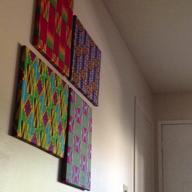 DIY fabric covered canvas'... Fabric came from my sisters trip to Ghana... Needed to show it off. Super easy and cheap and there are great tutorials on YouTube