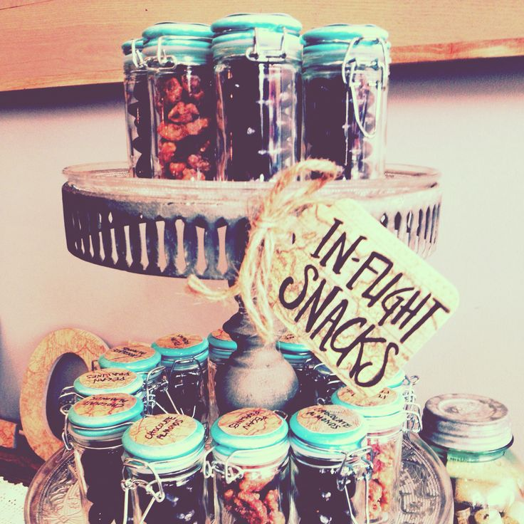 In-flight snacks for a travel themed bridal shower. Got the jars at World Market…