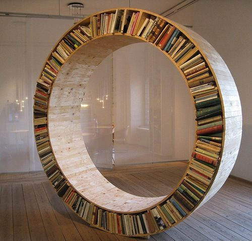 Would be neat in a library room... Built as a nook with a curved cushion on the inside and some cool throw pillows....