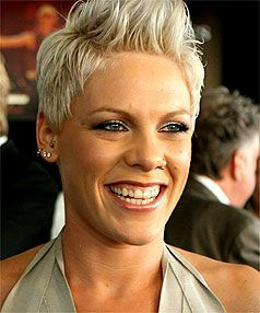 Love her look and bad ass haircut with color! All the time!  Google Image Result for http://fabulousbuzz.com/wp-content/uploads/2010/11/2331523.jpg