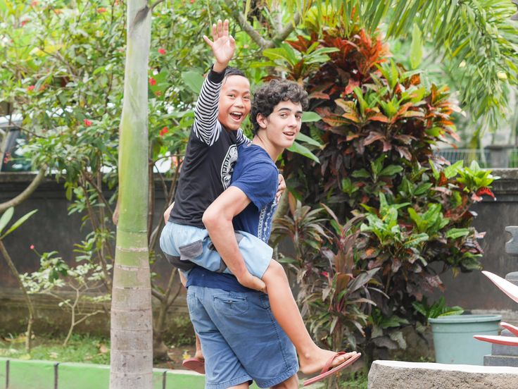 One of our students and volunteer Eduardo going to the playground together