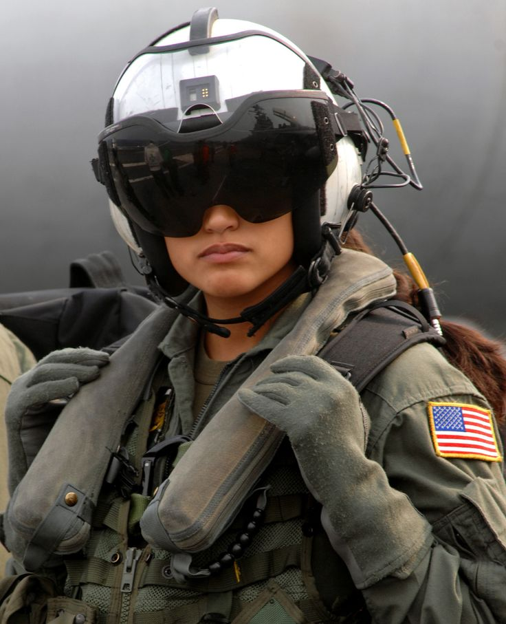 Aviation girl  Rocio Britos  (US Navy AWSO 2nd Class assigned to the Dusty Dogs of Helicopter Anti-Submarine Squadron (HS) 7) waits to board an SH-60 Seahawk on board Nimitz-class aircraft carrie.