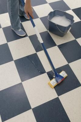 Self-adhesive vinyl floor tiles make do-it-yourself installation feasible for many home owners. The seams between tiles can trap dirt and moisture, which loosen tiles over time, but sealing the floor helps the seams resist infiltration of damaging materials