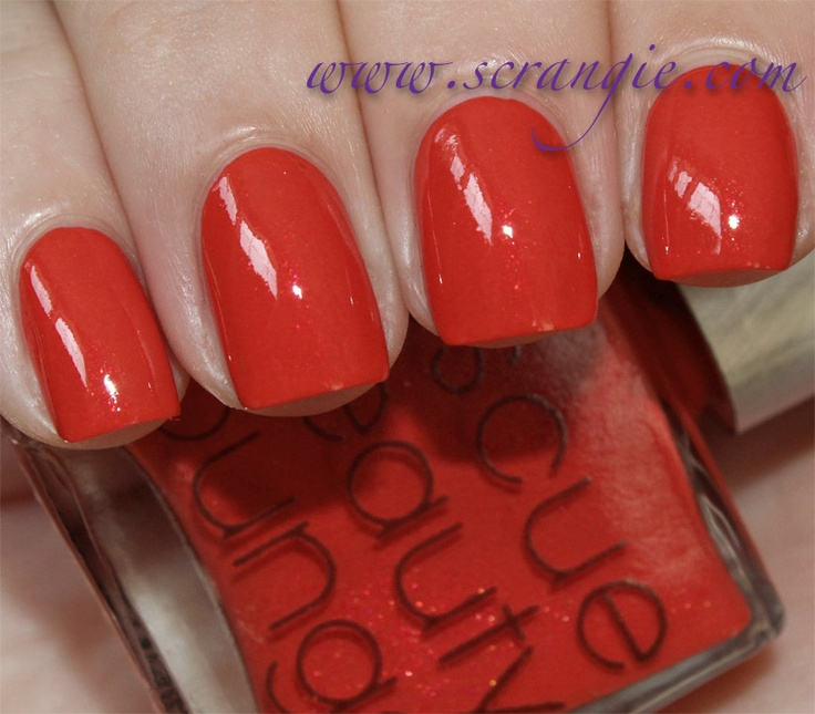 From Scrangie.com:  Rescue Beauty Lounge Oriental Poppy. Oriental Poppy is a warm, bright poppy red with subtle pink-red-orange duochrome glass fleck shimmer.