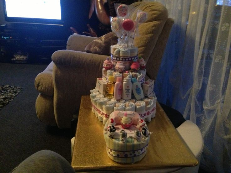 My mums Diaper cake & basinet for a raffle...Everything made from Baby accessories: wash cloths, nappies, blankets, sheets, socks, shorts and onesies