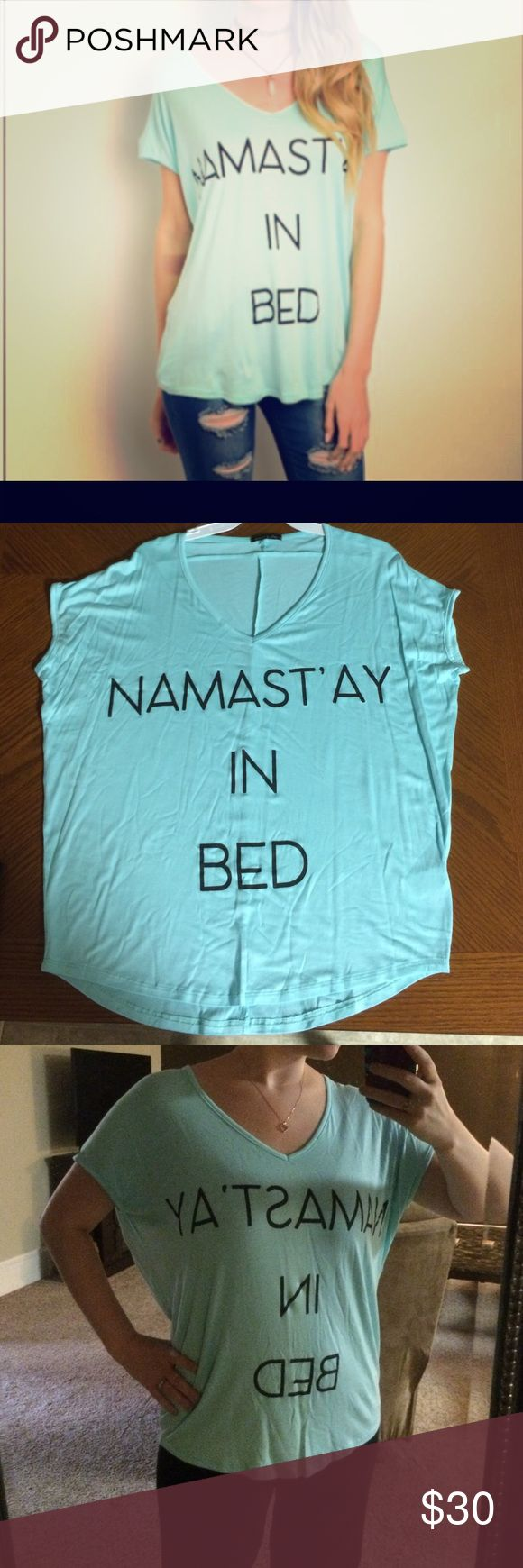 """Namast'ay in bed slouchy tee  """"Namast'ay in bed""""  teal colored slouchy tee shirt! So comfortable & incredibly flattering! I just love this shirt so much!  Fabric- 96% rayon & 4% spandex. Approximate flat measurements:  Small- length 27"""" width 21 1/2""""                         Medium- length 27"""" width 22 1/2""""                                Large- length 28 width 23 1/2"""" Tops Tees - Short Sleeve"""