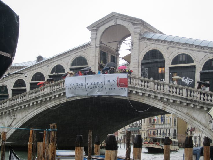 The Rialto Bridge in Venice, Italy.  One of four bridges that spans the Grand Canal in Venice.   Oldest bridge across the canal was built between 1588 & 1591.  It is 75.1 ft wide, 24 ft tall, and spans 94.5 ft across the canal.